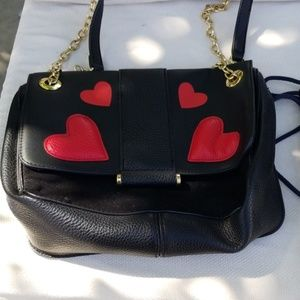 Black purse with red hearts